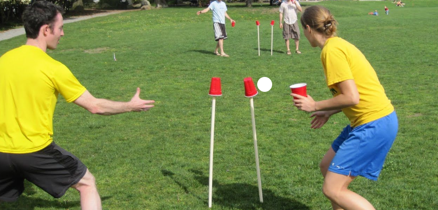 Group of friends playing cups outdoors
