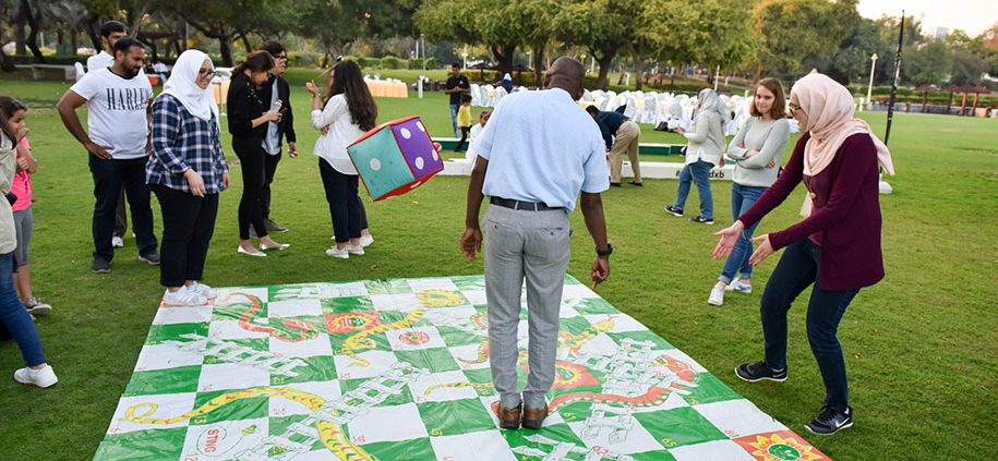 family laying snakes and ladders before a wedding