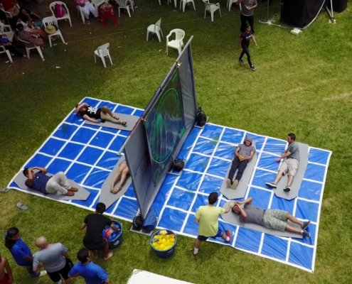 Friends and family playing life-sized water balloon battleship