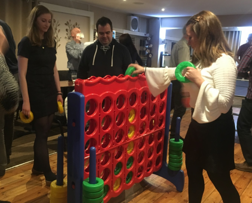 Giant connect 4 players