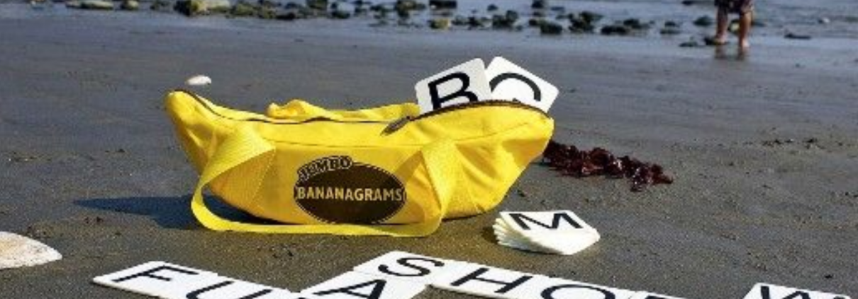 Playing giant bananagrams on the beach